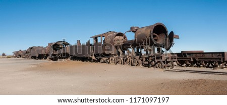 Rusty old and abandoned trains at the Train Cemetery (Cementerio de Trenes) in Uyuni desert, Bolivia - South America