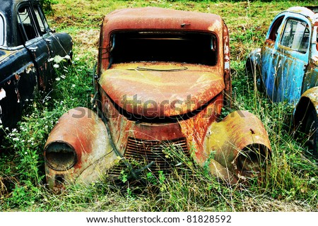 Rusty old car wreck - stock photo