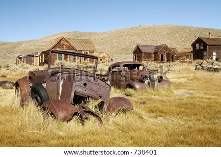 Rusty old cars in a ghost town in California.