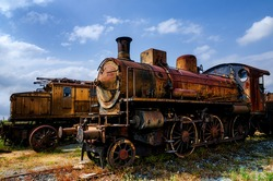 Rusty old italian steam and electric locomotives