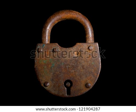 Rusty old lock on black - stock photo