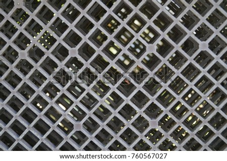 Rusty old metal grate with rhombus holes  #760567027