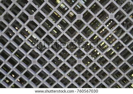 Rusty old metal grate with rhombus holes  #760567030