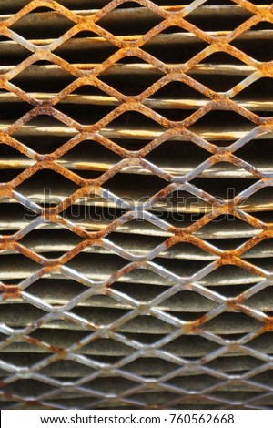 Rusty old metal grate with rhombus holes.  Dirty air filter of car engine  #760562668