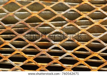 Rusty old metal grate with rhombus holes.  Dirty air filter of car engine  #760562671