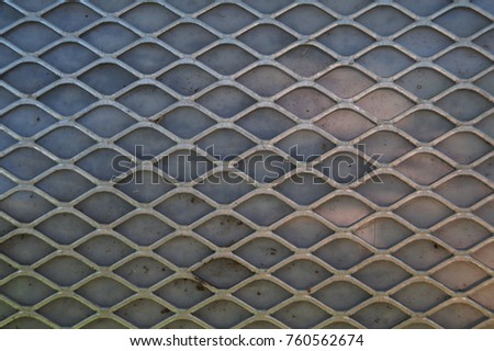 Rusty old metal grate with rhombus holes.  Dirty air filter of car engine  #760562674