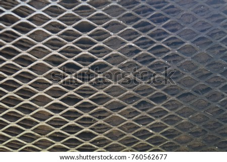 Rusty old metal grate with rhombus holes.  Dirty air filter of car engine  #760562677