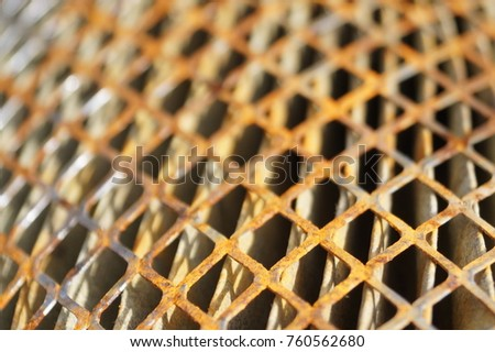 Rusty old metal grate with rhombus holes.  Dirty air filter of car engine  #760562680