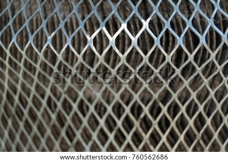 Rusty old metal grate with rhombus holes.  Dirty air filter of car engine  #760562686