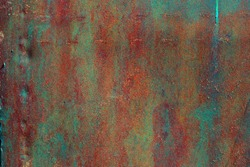 Rusty old painted metal background. Cracked texture. Corrosion of metal.