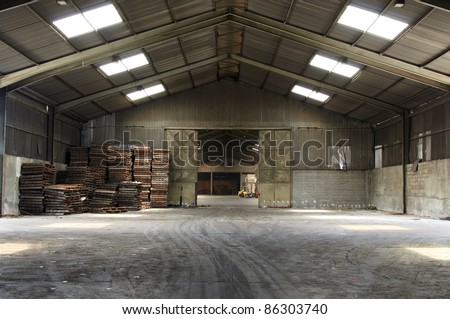 Rusty old pallets in abandoned warehouse