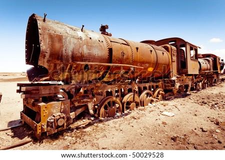 Rusty old steam train in Bolivian desert