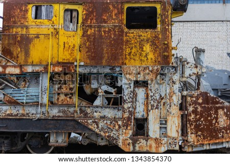 Rusty old weathered train standing outdoors. Horizontal color photography. #1343854370