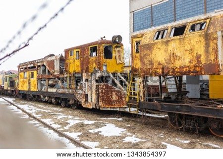 Rusty old weathered train standing outdoors. Horizontal color photography. #1343854397