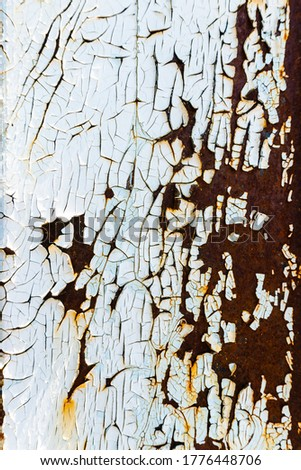 Rusty painted metal. Texture of rusty iron wall. Cracked paint on an old metallic surface. Cracked and flaky paint, abstract rusty metal texture, rusty metal background. Metal corrosion