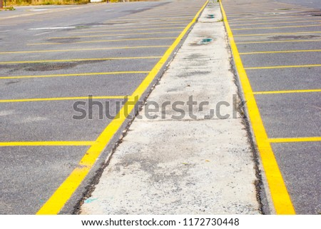 Rusty perspective shape metal and yellow striped parking area Large blue glass building with wonderful backgrounds opens in different perspectives. #1172730448