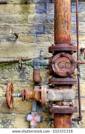 Rusty Pipes, Dean Clough Mills, Halifax, Calderdale, UK - stock photo