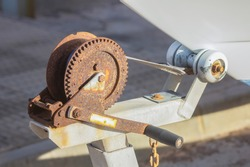rusty pulley to raise a trailer boats