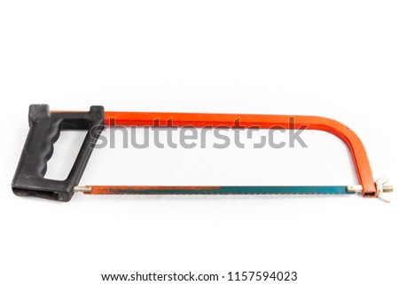 rusty red hacksaw on a white background in studio