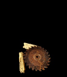 Rusty saw blade with wood chips on black background. carpentry concept