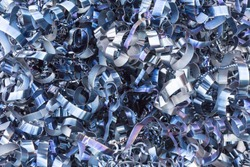 Rusty scrap metal shavings swirls in blue tone.