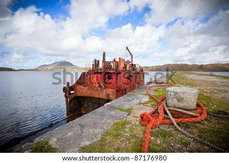 Rusty Ship Wreck at the pier in Connamara, Ireland