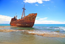 Rusty shipwreck in shallow water on a beach near Gythio, Greece