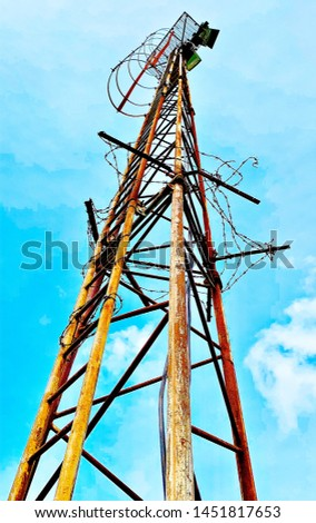 Rusty sports field floodlights tower #1451817653