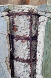 Rusty steel bars and broken concrete