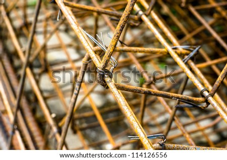 Rusty steel rod reinforcement before pouring concrete. - stock photo