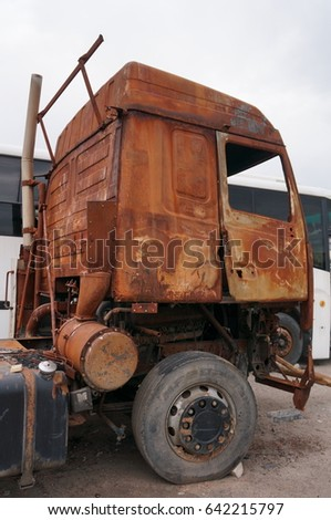 Rusty truck - a tractor after a fire and accident