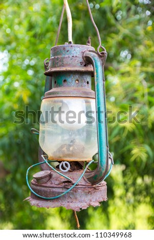 Rusty vintage and very old lantern with electric lamp