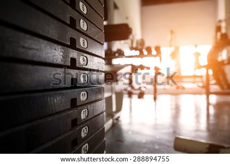 rusty weight stack in a gym