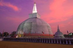 Ruwanweli Maha Seya Dagoba  close-up on a sunset background. Anuradhapura, Sri Lanka