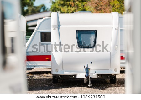 RV Travel Trailer Storage Parking. Modern Recreational Trailer with Front Window. Camping and Traveling Theme.