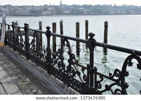 Ryde Pier said to be second longest pier in England. Wrought iron decorative railings and wood boardwalk. #1373676380