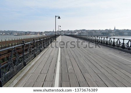 Ryde Pier said to be second longest pier in England. Wrought iron decorative railings and wood boardwalk. #1373676389
