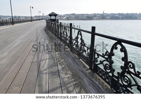 Ryde Pier said to be second longest pier in England. Wrought iron decorative railings and wood boardwalk. #1373676395