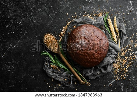 Rye black round bread. Baking from rye and flour. Top view. Сток-фото ©