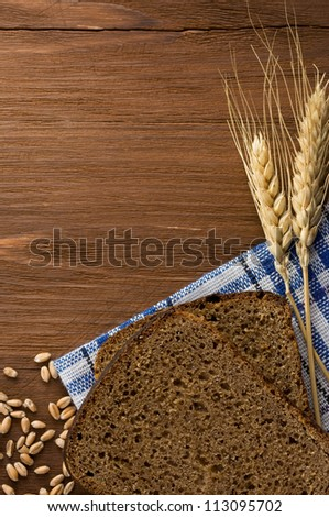 rye bread and ears of wheat on napkin