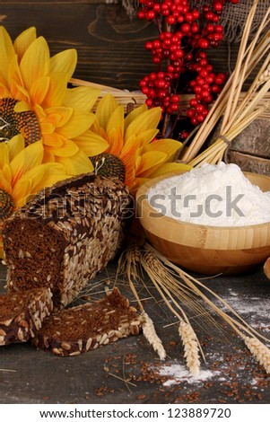 Rye bread on wooden table on wooden background