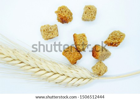 Rye crackers and rye spike located on a white background #1506512444
