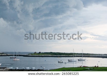 Rye, NH, USA - August 7, 2014: Sailboats fill Gosport Harbor as a summer storm passes overhead.