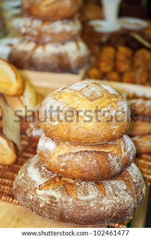 Rye round freshly baked bread at bakery. - stock photo