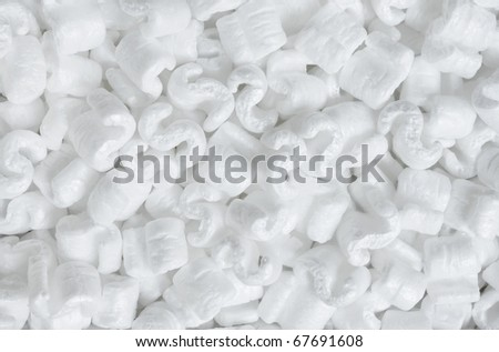 S-shaped white packing peanuts as a background