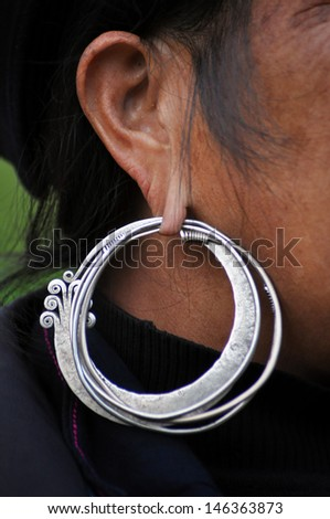 SA PA, VIETNAM - FEB 22: An unidentified old Black H'mong woman with a silver earring. The H'mong people are one of the largest ethnic minorities in Vietnam.  On Feb. 22, 2013 in Sapa, Vietnam