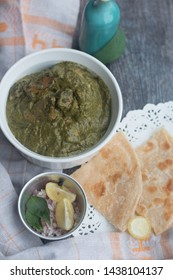 Stock Photo of Saag Chicken it contains Chicken, cooked in Palak gravy (Spinach) with Indian spices. Served with roti (flat Indian bread)