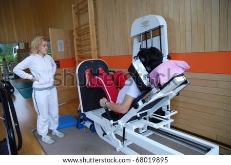 SAALFELDEN, AUSTRIA - AUGUST 30: physical therapist assisting female patient on August 30, 2007 at rehabilitation center in Saalfelden, Austria.