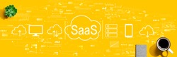 SaaS - software as a service concept with a cup of coffee and a notebook