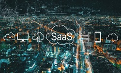 SaaS - software as a service concept with aerial cityscape view of Japan at night
